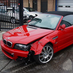Red BMW with front end damage from collision