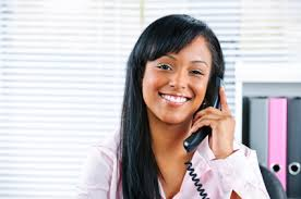 Woman smiling while answering phone