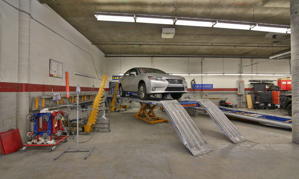 View of vehicle on a lift in Seidner's Collision Center garage